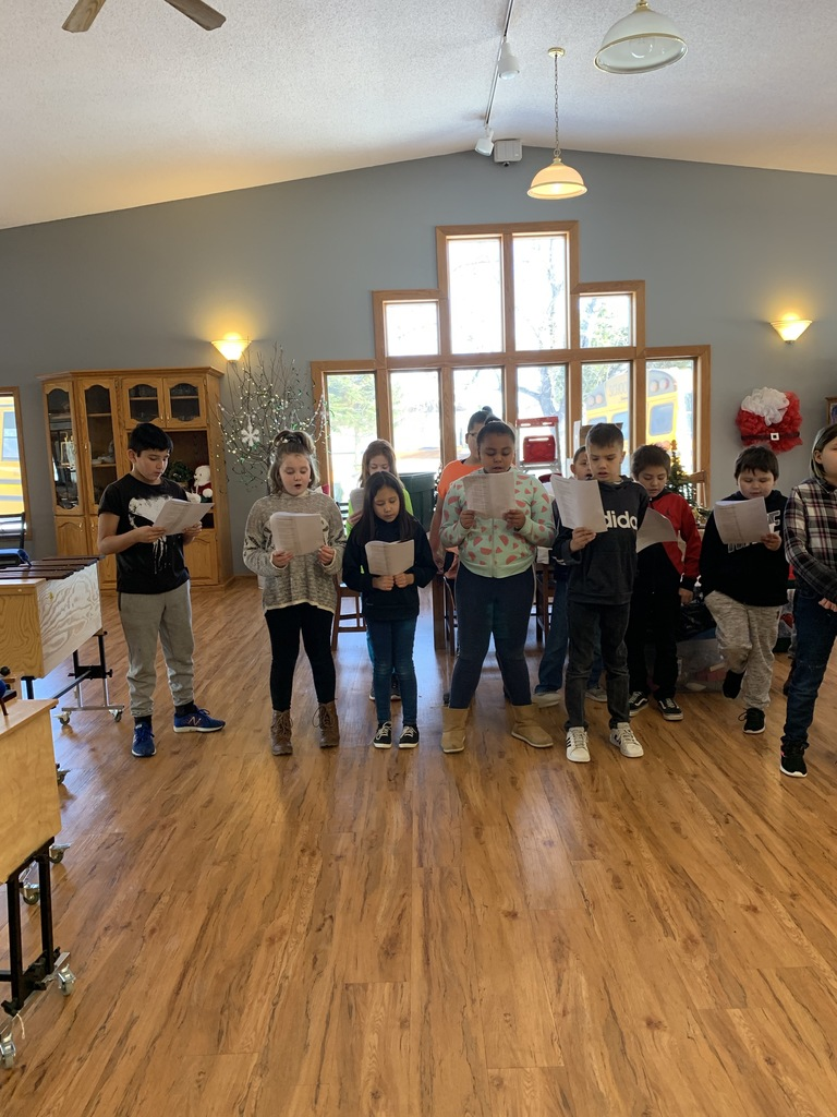 Some of the 4th graders singing Christmas carols